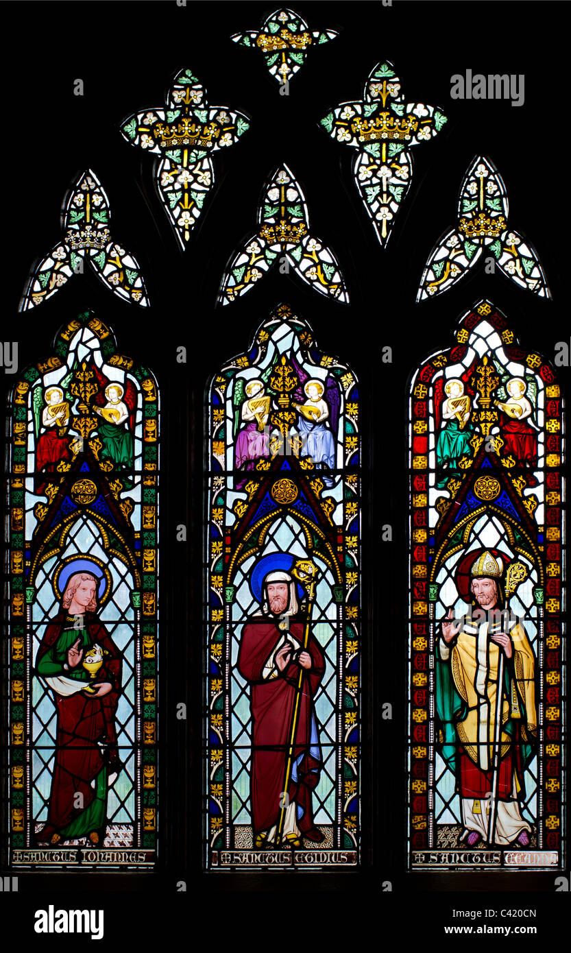 South aisle window depicting St. John the Evangelist, St. Giles and St. Chad - Stock Image