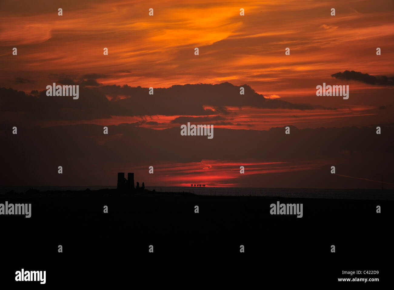 Sunset behind Reculver Towers and Shivering Sands Army Fort in Kent - Stock Image