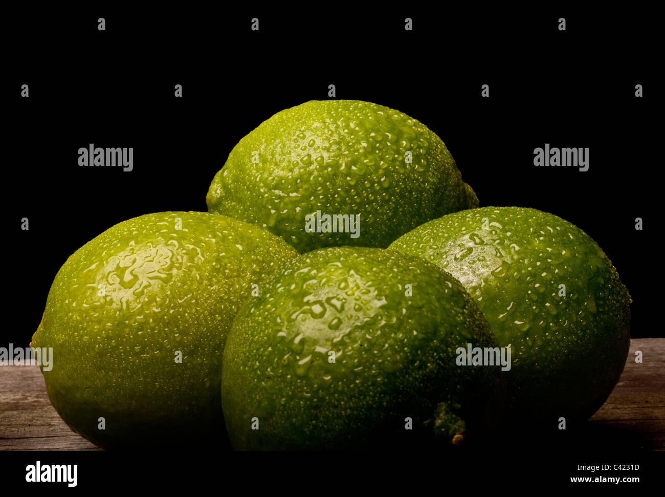 4 Limes on a table, Food - Stock Image