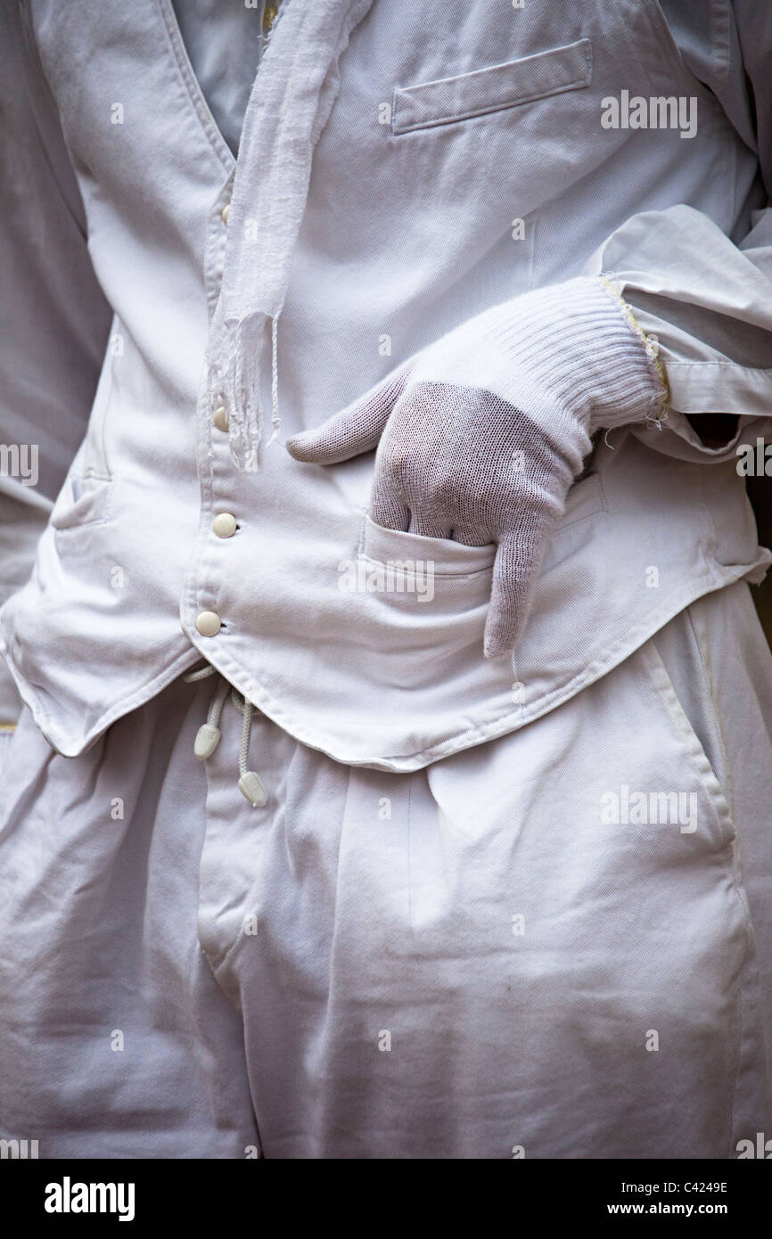 White gloved hand in pocket France - Stock Image