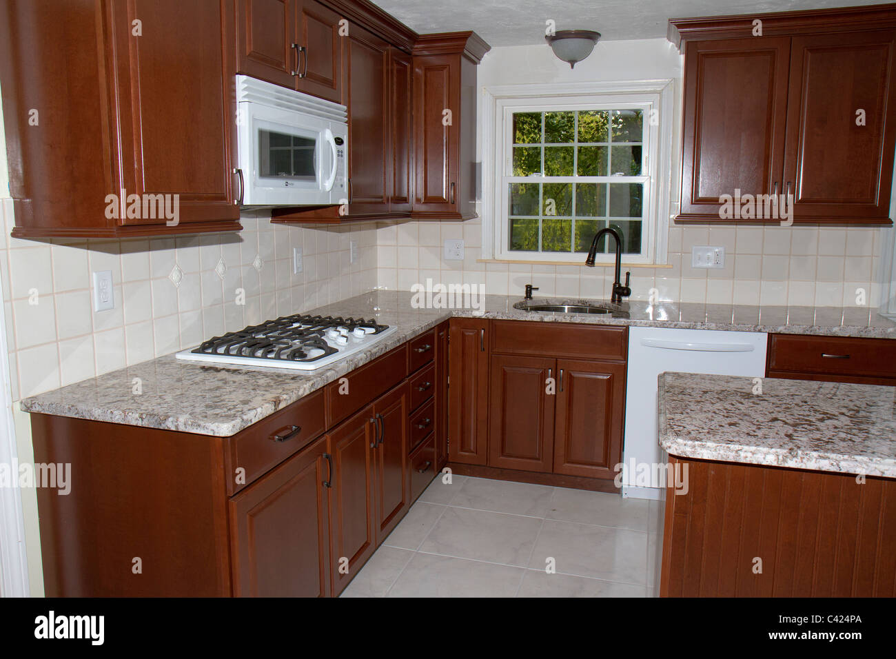 New cherry cabinets granite counter tops and ceramic tile floor new cherry cabinets granite counter tops and ceramic tile floor stock photo 36927026 alamy dailygadgetfo Image collections