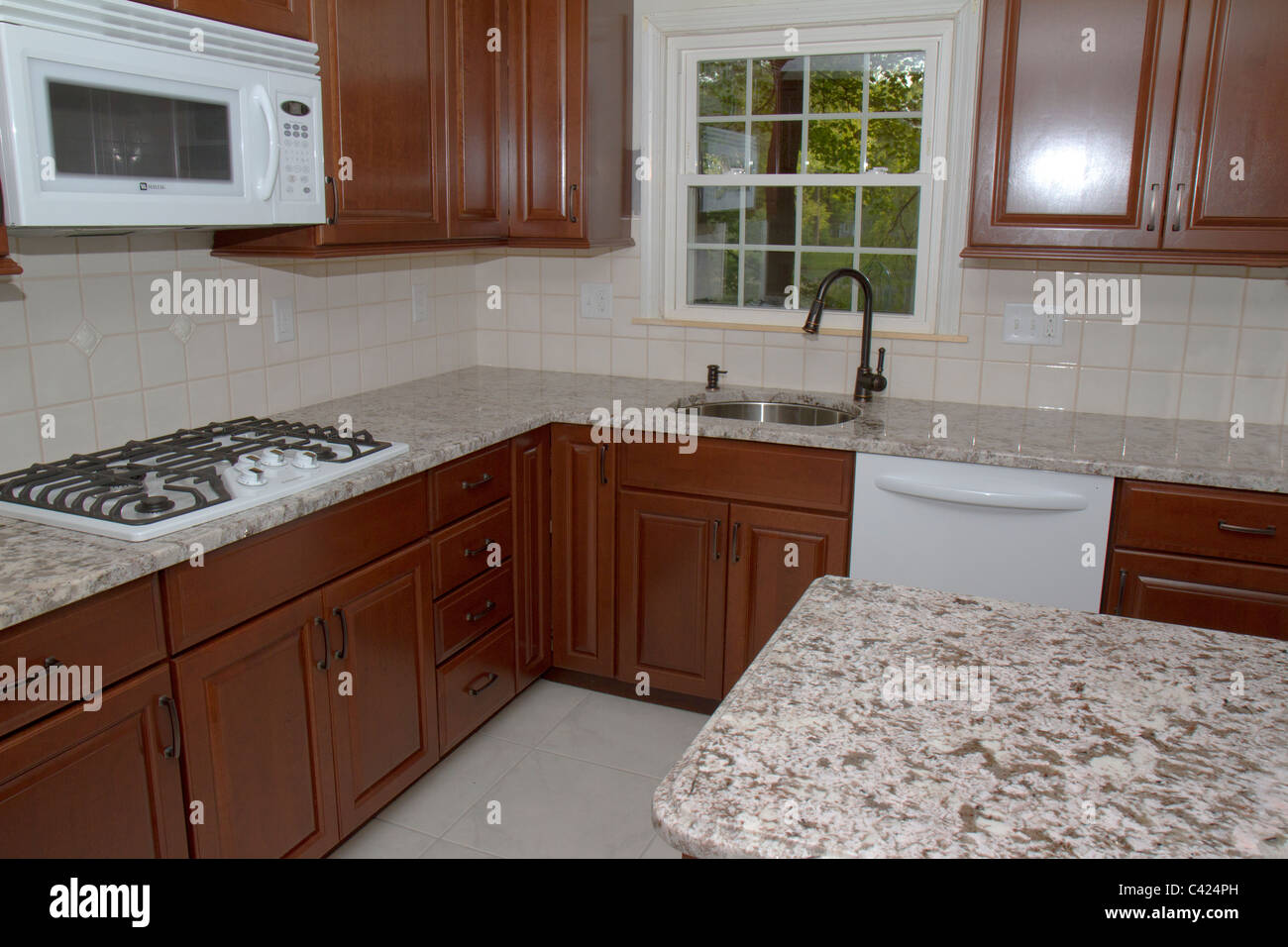 New cherry cabinets, granite counter tops, and ceramic tile floor ...