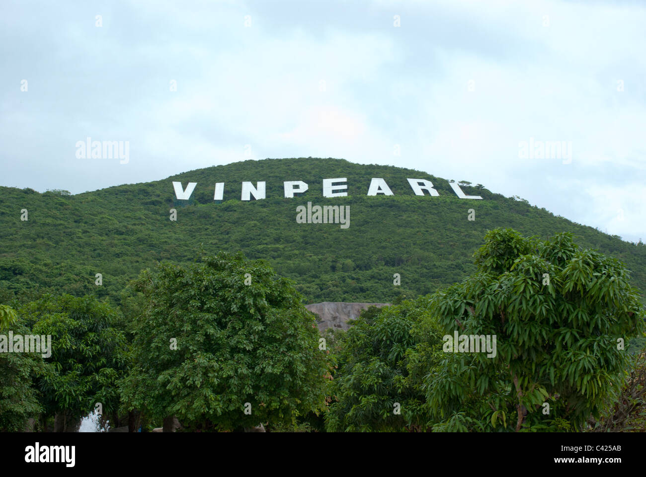 Vinpearl sign on a mountain similar to Hollywood sign in Nha Trang, Vietnam - Stock Image
