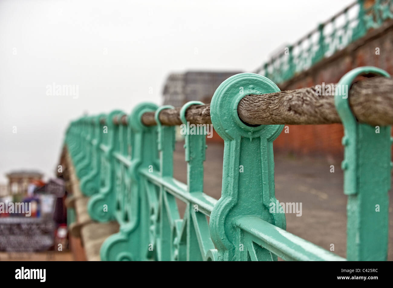 A handrail on the seafront at Brighton - Stock Image