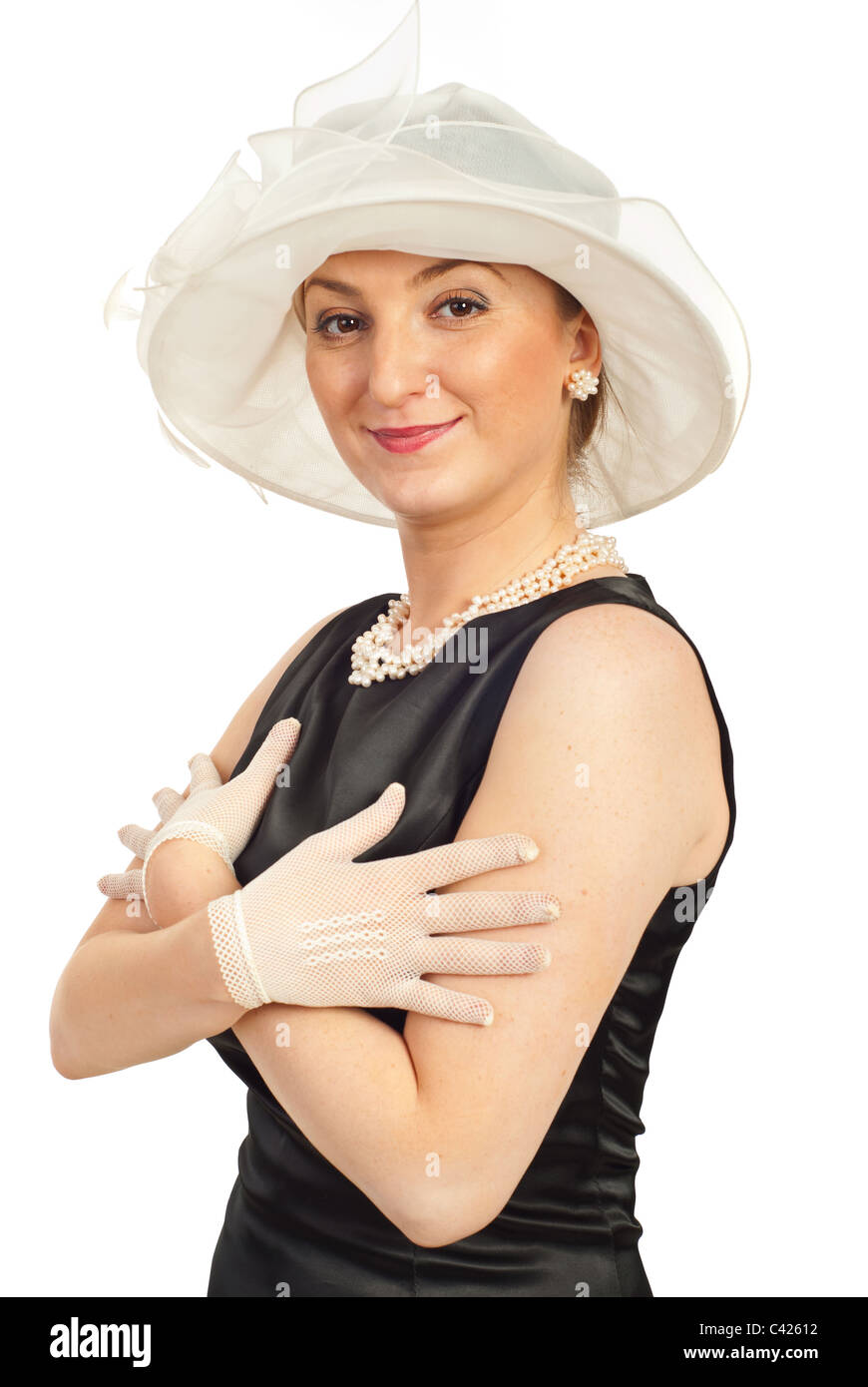 e1ba005c82e2d Smiling elegant woman in satin black dress wearing hat and gloves isolated  on white background -