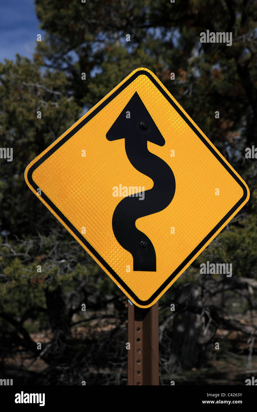 winding road ahead warning sign in the USA - Stock Image