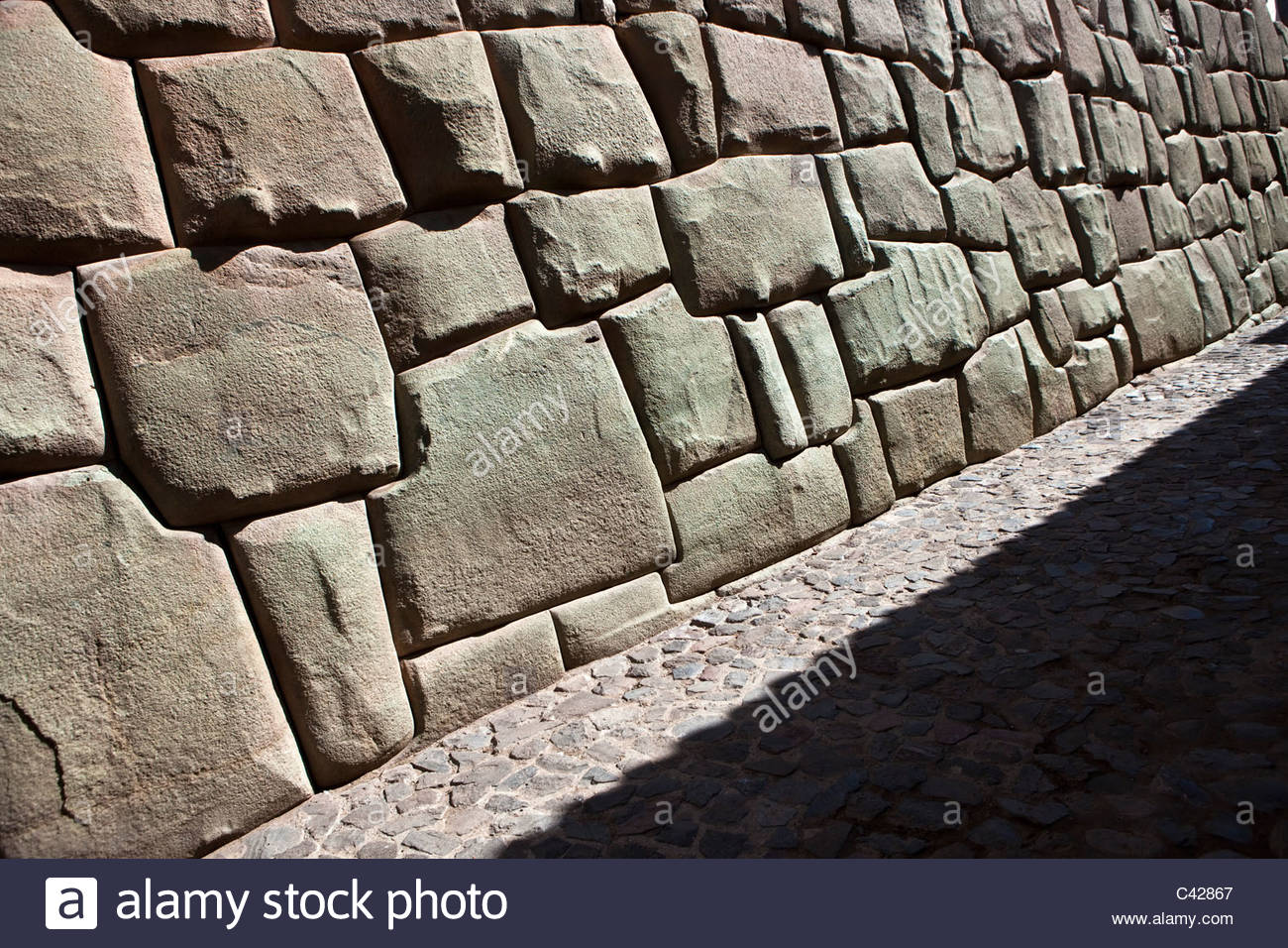 Cuzco, Wall of the Museum of Religious Art, before belonging to the Sixth Inca, Inca Roca. Examples of polygonal - Stock Image