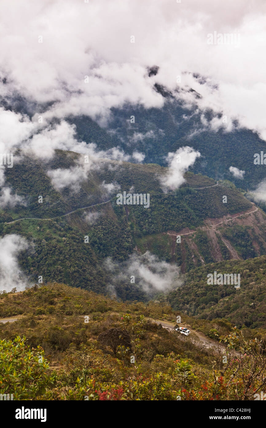Peru, Las Cruses, road in cloud forest. Tourists in car to Manu National Park. UNESCO World Heritage Site. - Stock Image