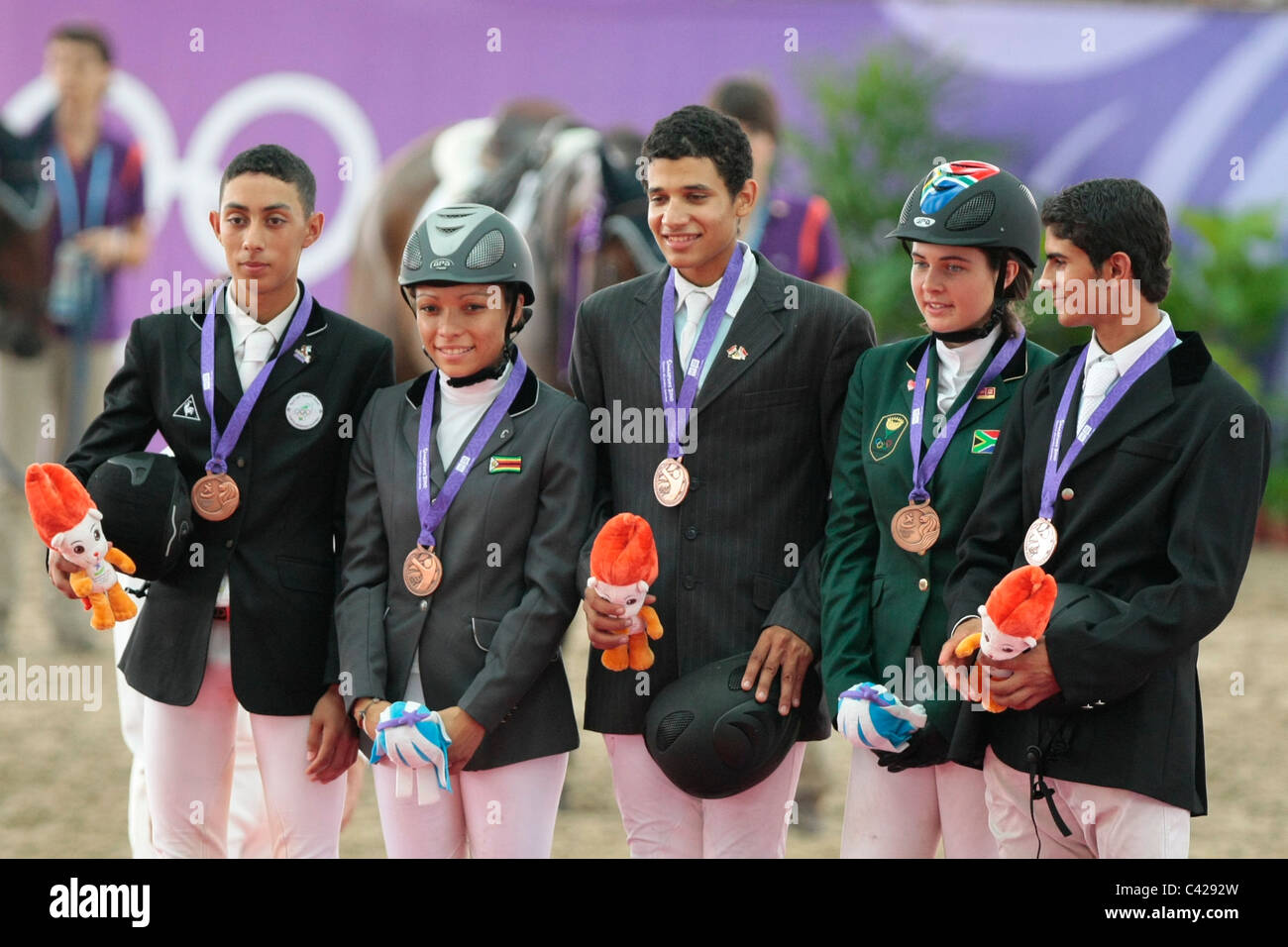 Team Africa clinches the bronze medal in the 2010 Singapore Youth Olympic Games Equestrian Team Jumping. - Stock Image