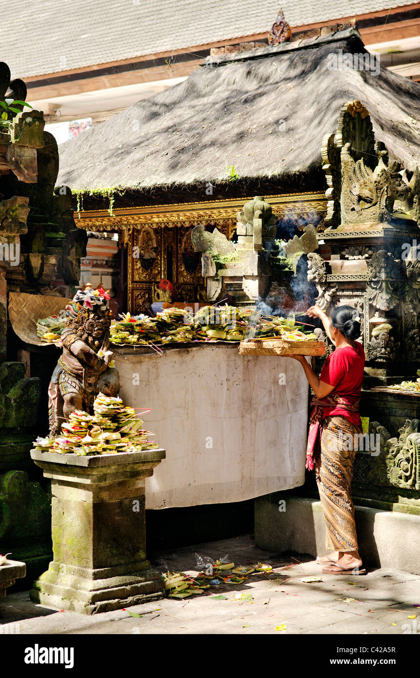woman at ubud temple in bali indonesia - Stock Image