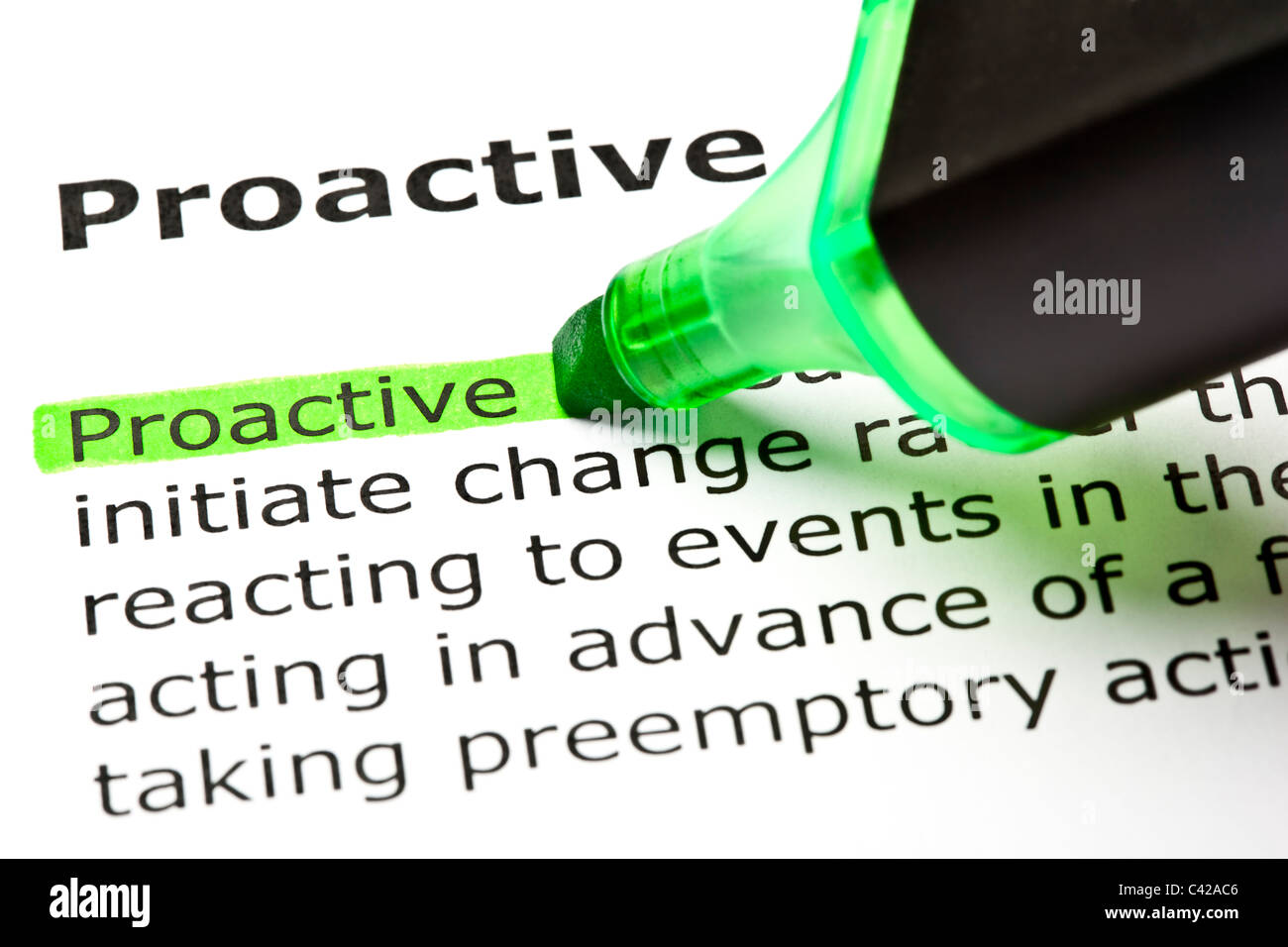 The word 'Proactive' highlighted in green with felt tip pen - Stock Image