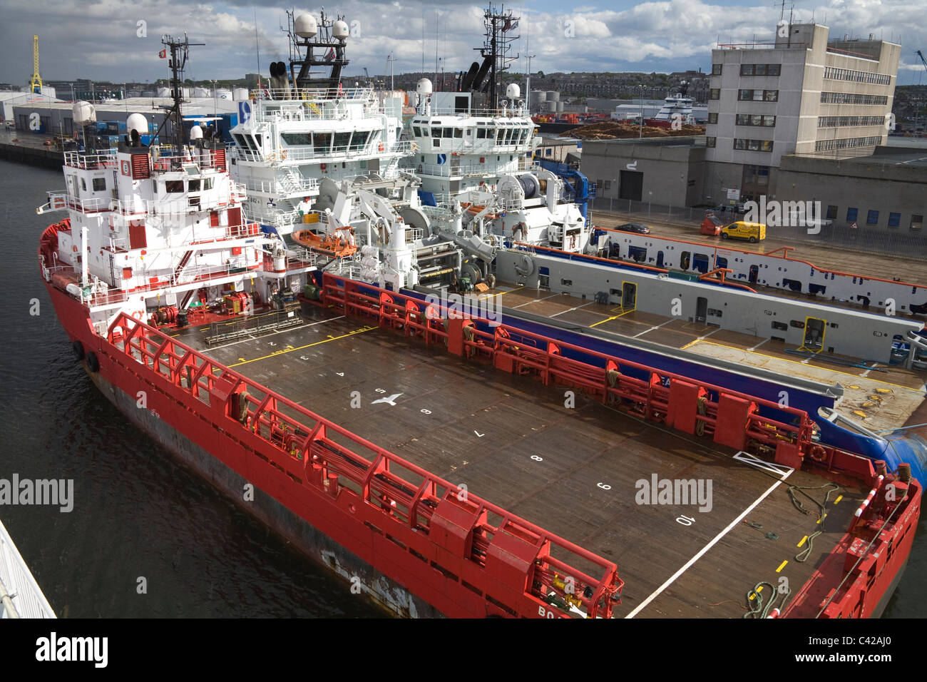 Aberdeen Scotland UK Looking down on three ships moored in harbour - Stock Image