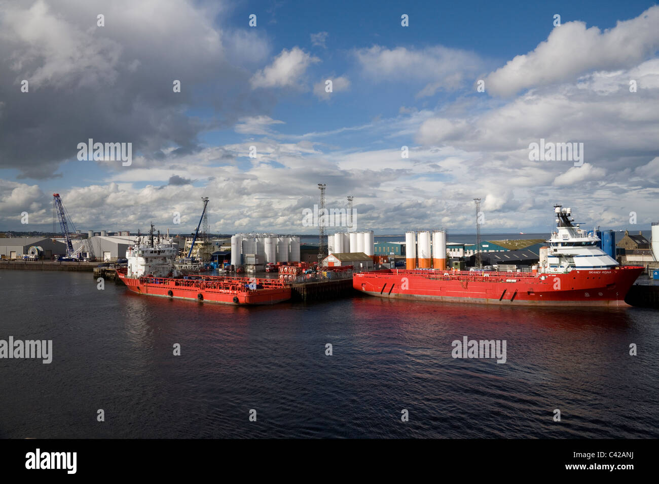 Aberdeen Scotland UK Skandi Falcon and Rona Norwegian cargo vessels moored at the dock side of this busy harbour - Stock Image