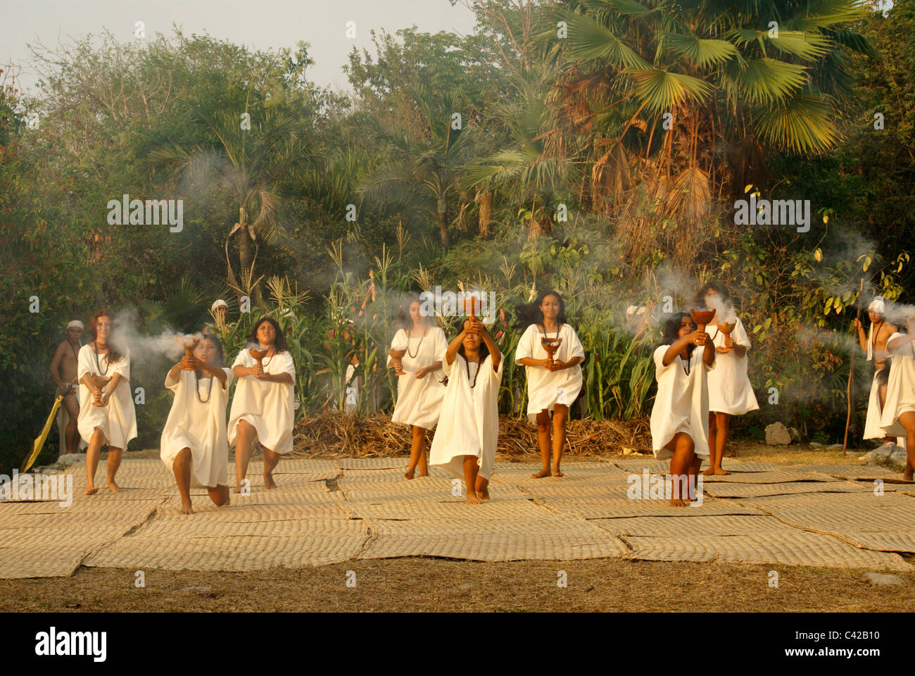 Dancers performing purification ritual at the Sacred Mayan Journey 2011 event, Riviera Maya,  Xcaret Park, Quintana - Stock Image