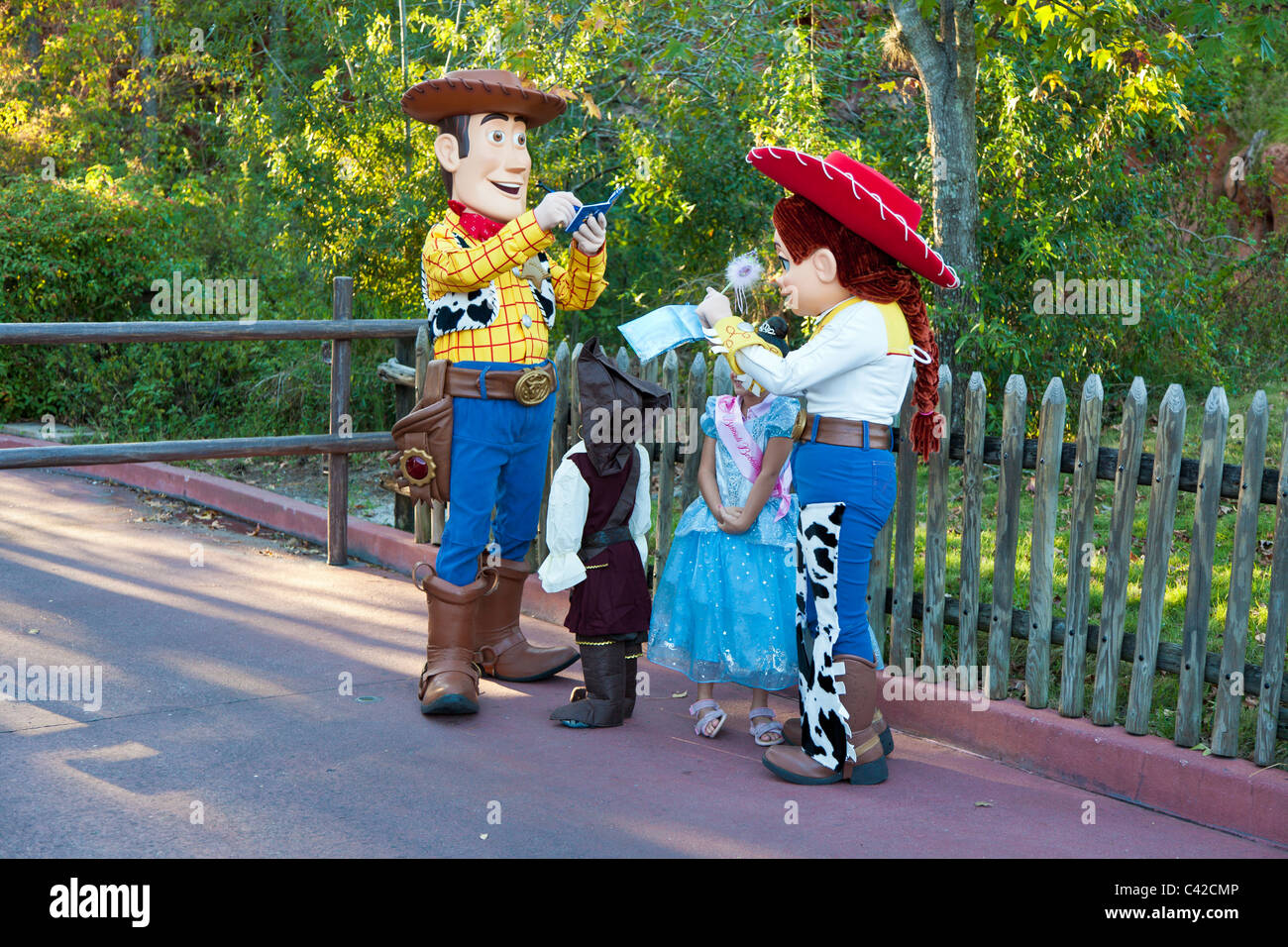 Toy Story characters Woody and Jessie sign autographs for young children in Magic Kingdom at Disney World, Kissimmee, - Stock Image