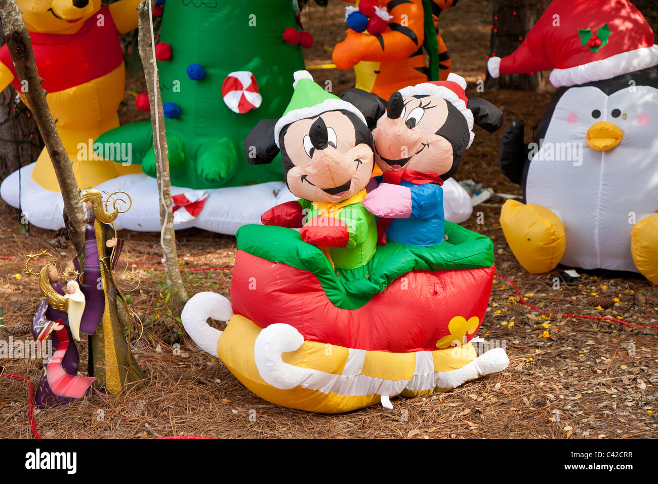 mickey and minnie mouse inflatable christmas holiday decorations in fort wilderness resort at walt disney world florida usa