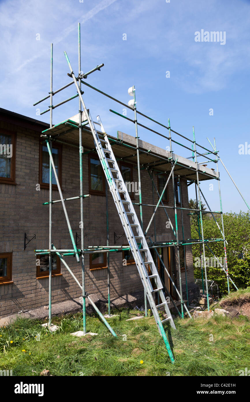 Scaffolding erected at side of house Wales UK - Stock Image