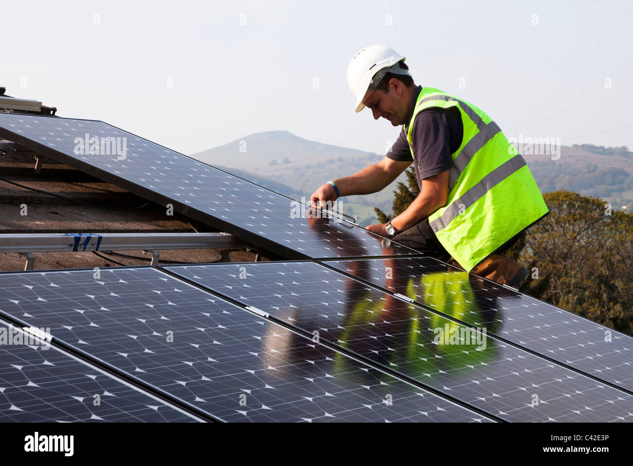 Fitting solar pv panels to house roof Wales UK - Stock Image