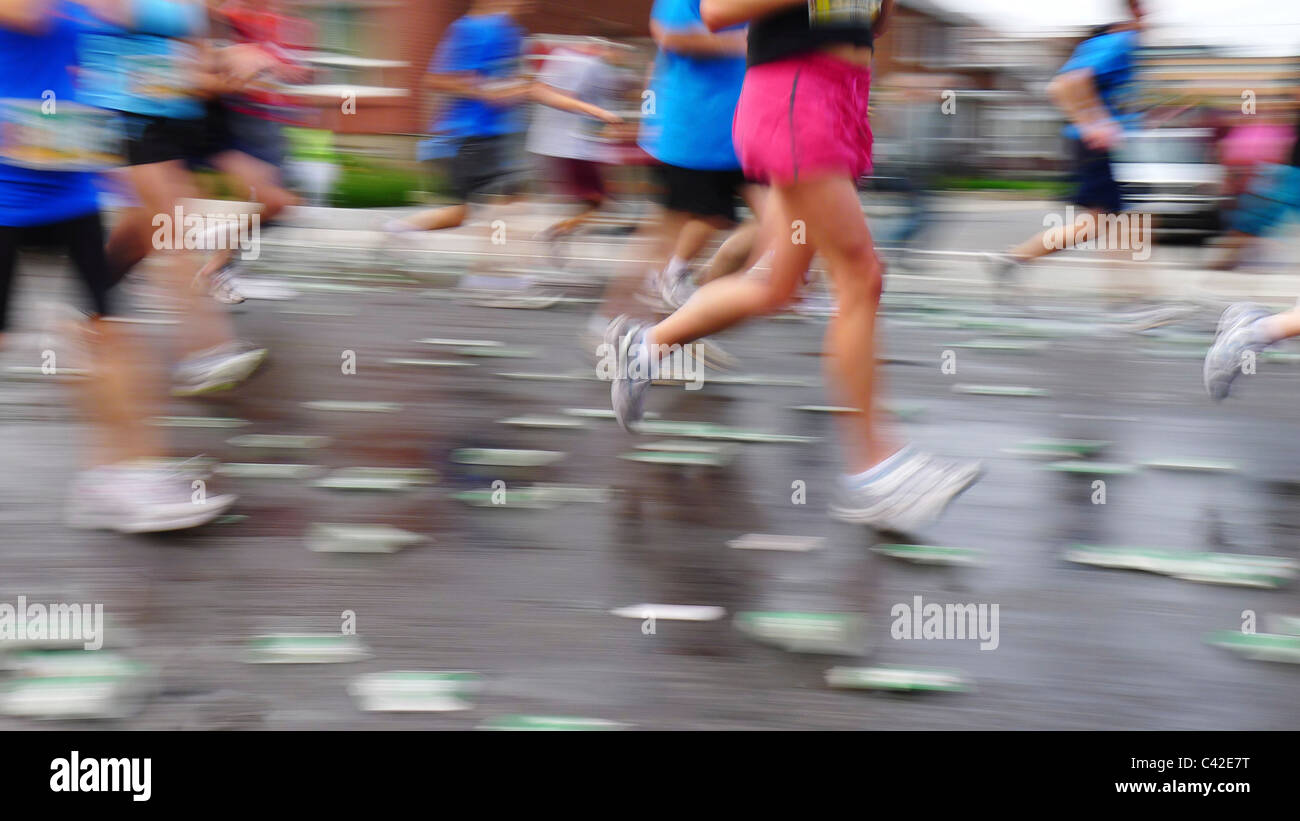 Blurring runners in a marathon running race, during the Ottawa Race Weekend. - Stock Image