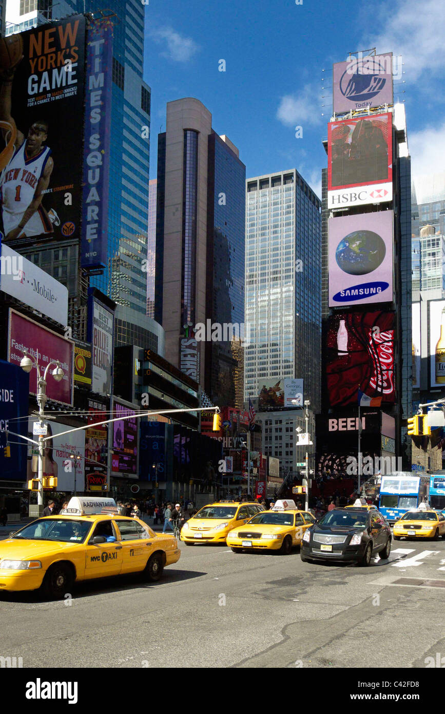 Cabs driving down 7th Avenue New York - Stock Image