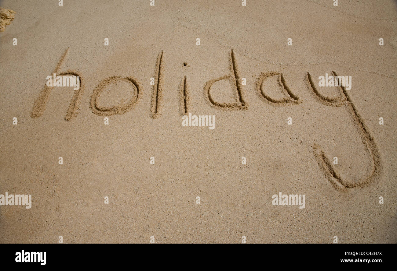 Holiday Writing in the Sand - Stock Image