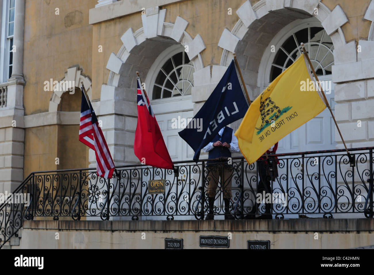 Flags of 17th century colonial period: Union Jack, US, Liberty, and 'Don't Tread on Me' displayed at - Stock Image