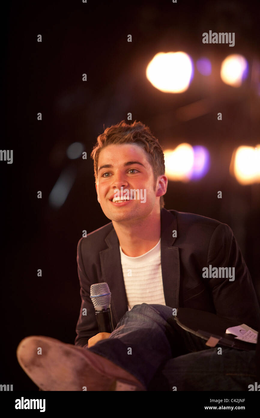 2009 X Factor winner Joe McElderry is interviewed on stage at Glasgow's 'Glam in the City' event Stock Photo