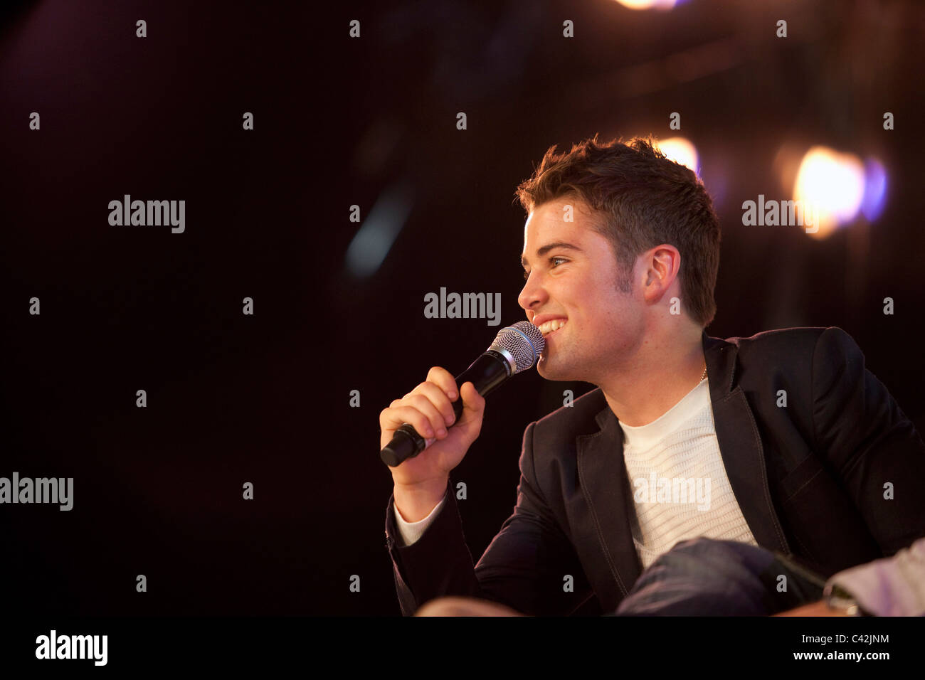 2009 X Factor winner Joe McElderry is interviewed on stage at Glasgow's 'Glam in the City' event - Stock Image