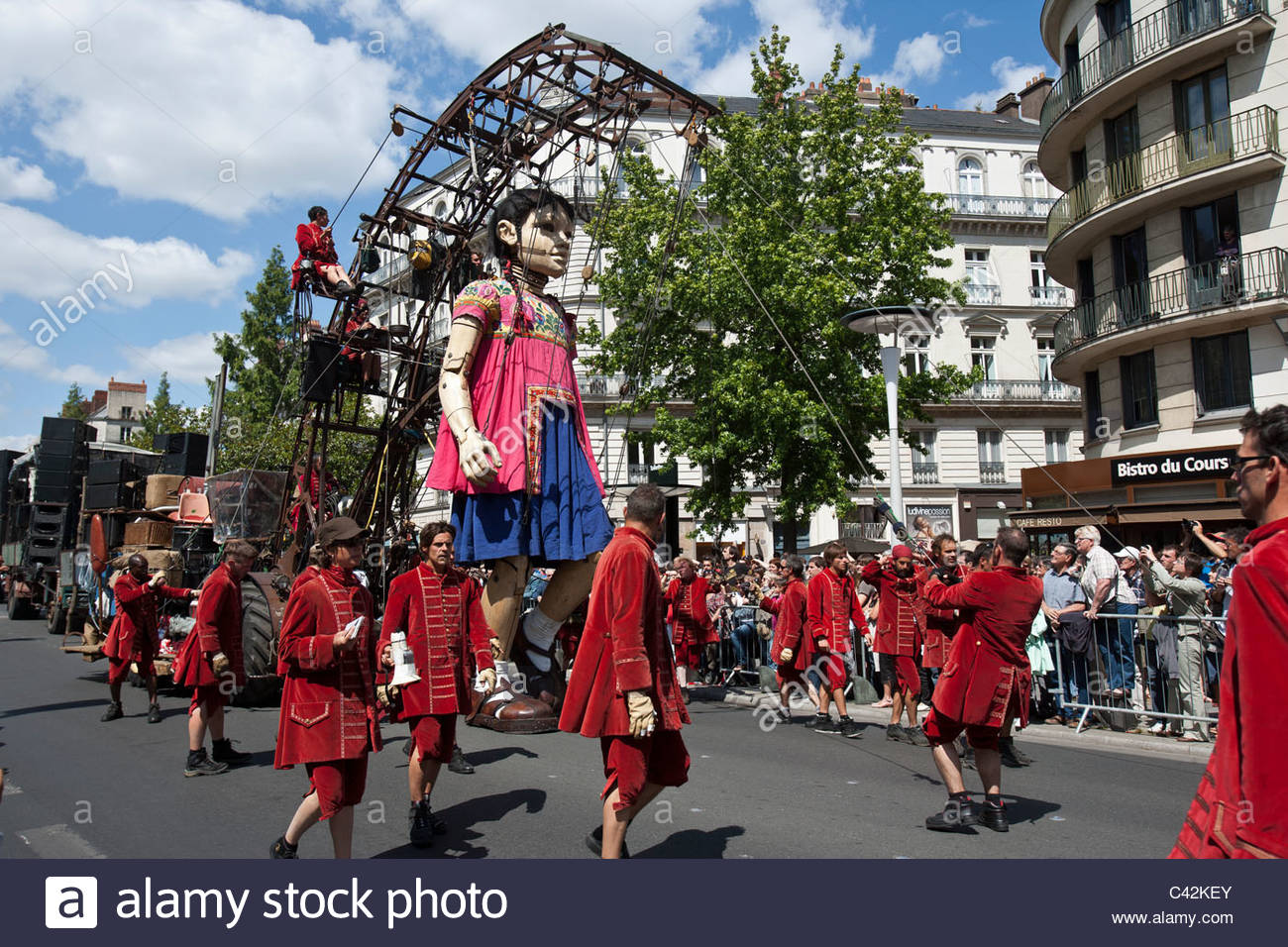 The Little Giant, a giant marionette by Royal de Luxe, walks through the streets in Nantes, France, May 27, 2011 - Stock Image