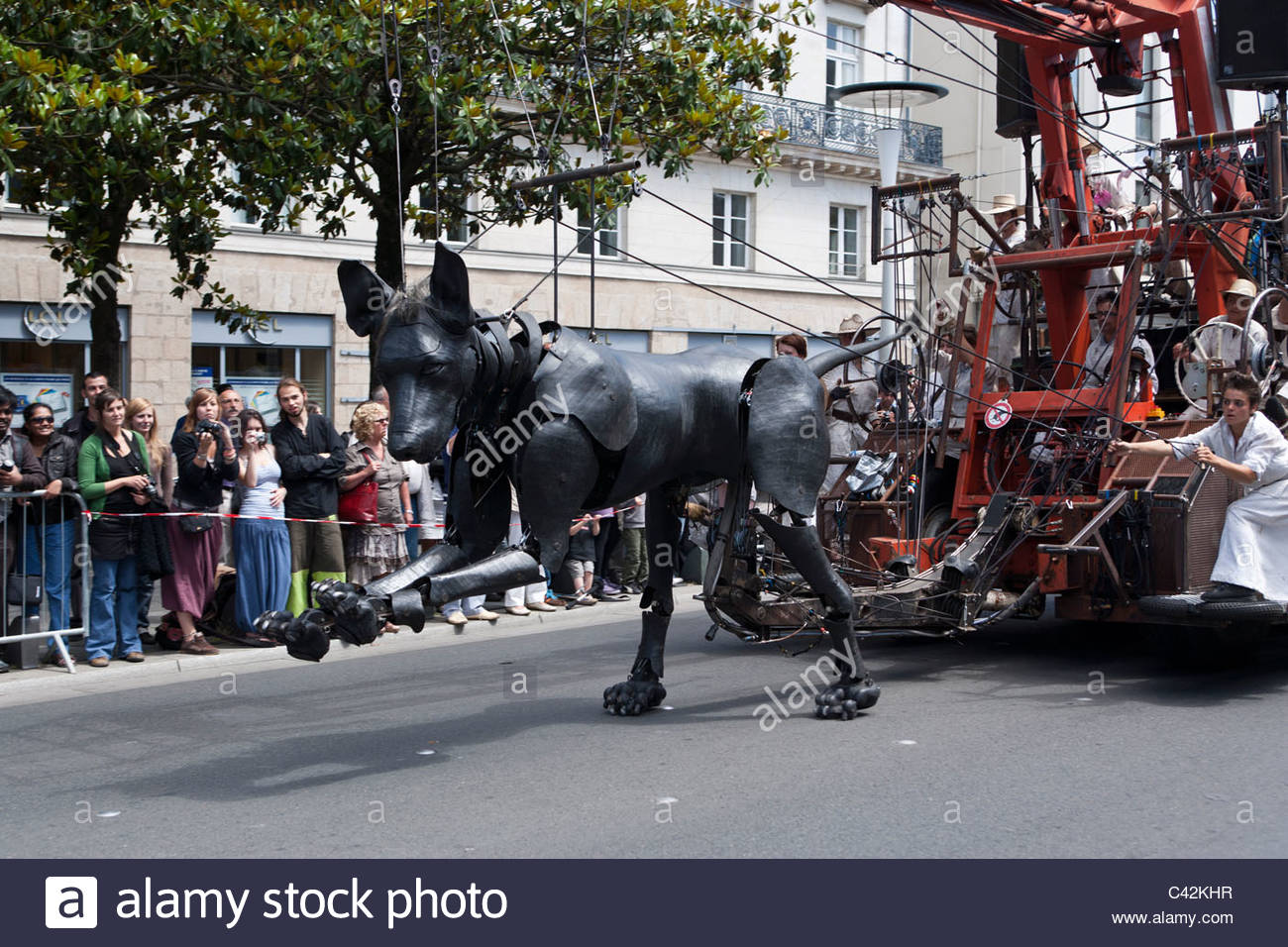 Xolo the dog, a giant marionette by Royal de Luxe, runs through the streets in Nantes, France, May 27, 2011 - Stock Image