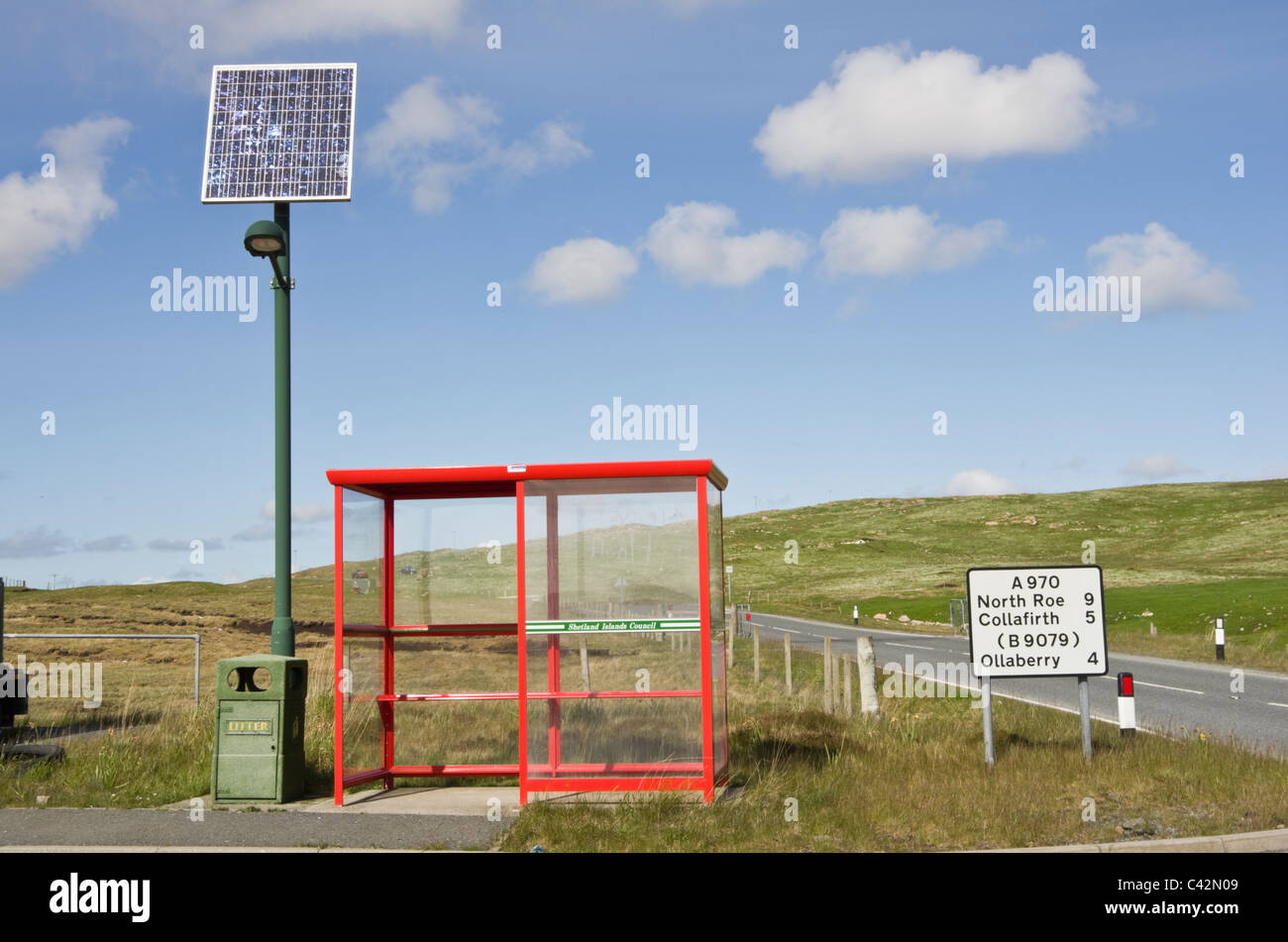 Rural bus shelter on a country road with street light powered by a solar panel. Northmavine, Shetland Islands, Scotland, - Stock Image