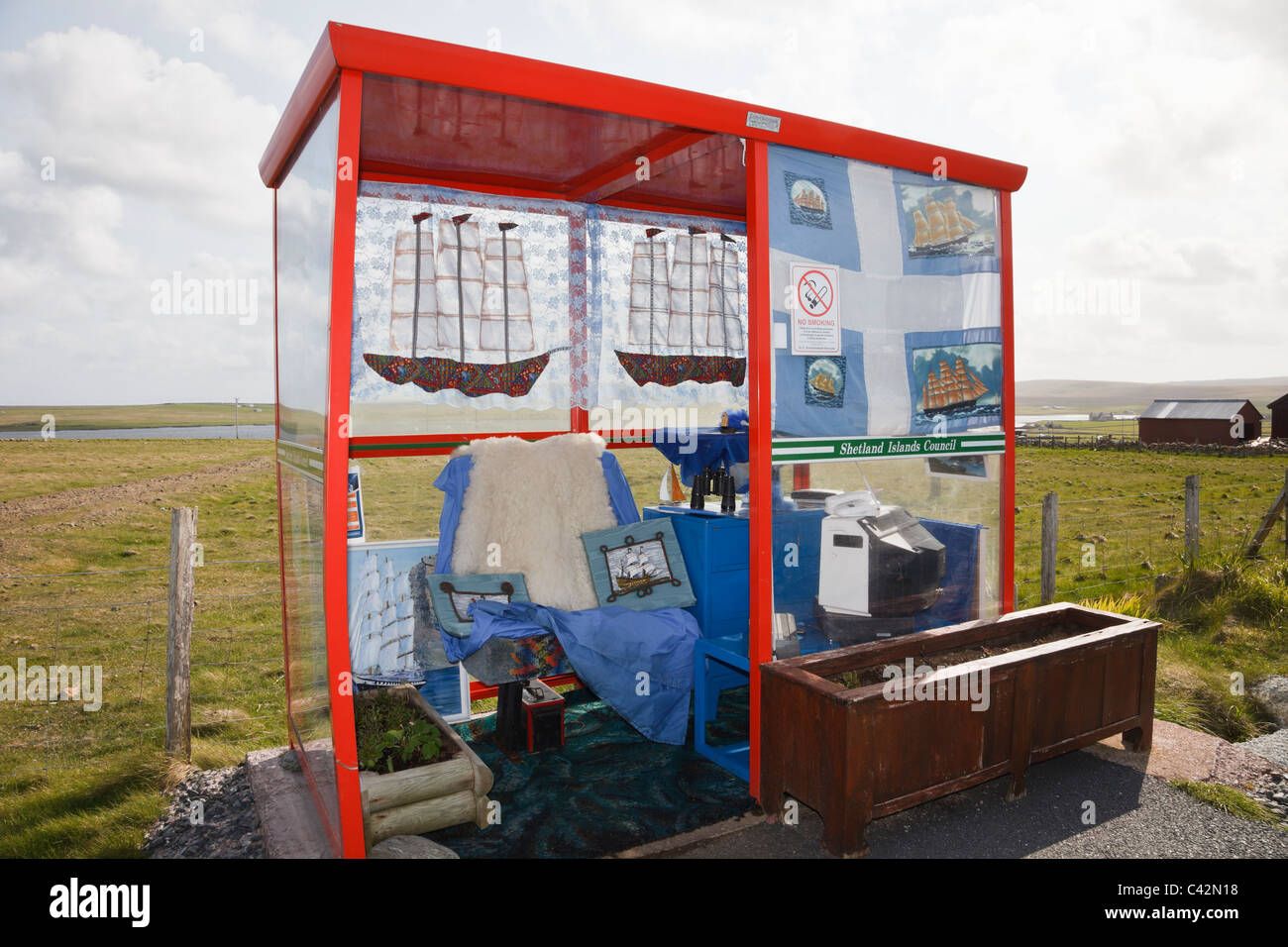 Rural bus stop shelter furnished and decorated with home comforts. Baltasound, Unst, Shetland Islands, Scotland, - Stock Image
