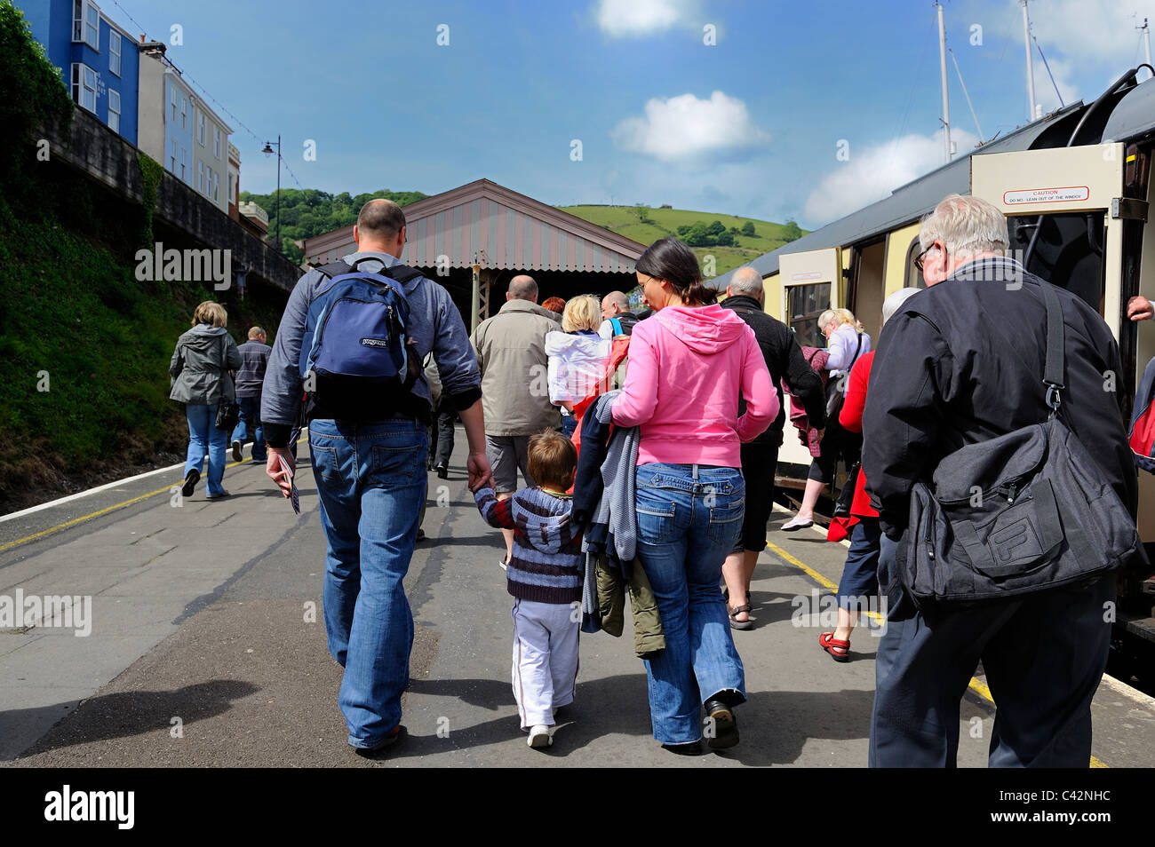 People walking down the platform at kingswear after arriving by steam train from Paignton devon england uk - Stock Image