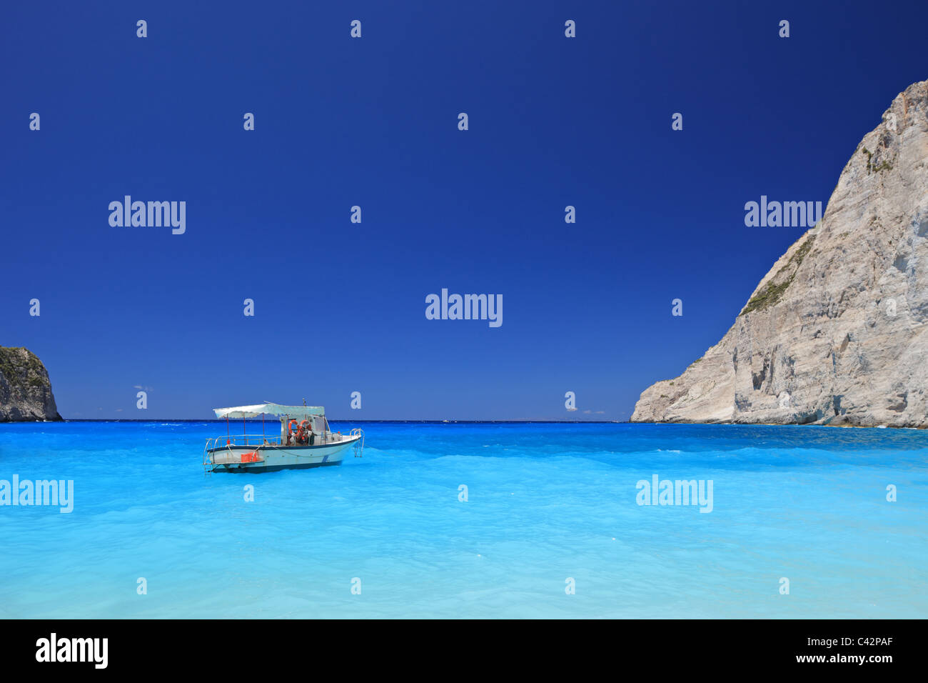 Boat anchored on Navagio beach (also known as shipwreck beach), Zakynthos island - Stock Image