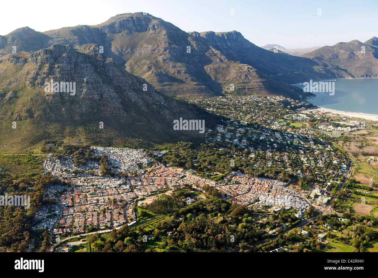 Aerial view of Imizamo Yethu township (aka Mandela Park) and part of the suburb of Hout Bay in Cape Town, South Stock Photo