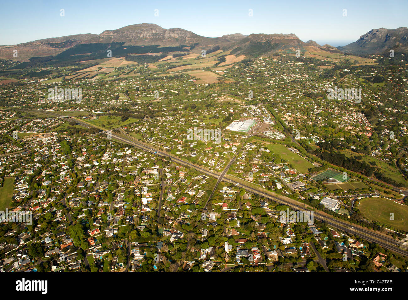Aerial view of Cape Town's southern suburbs including Constantia, Meadowridge and Plumstead. - Stock Image