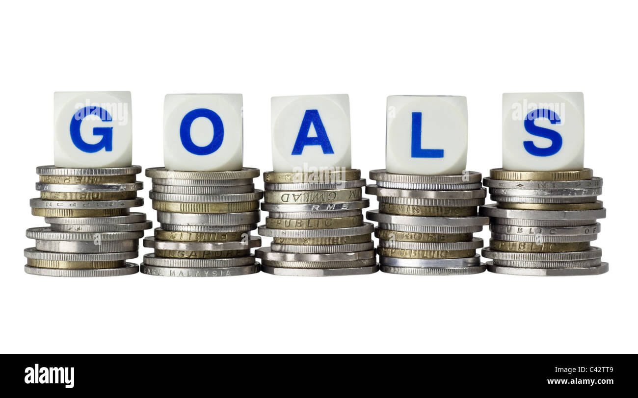 Stacks of coins with the word GOALS isolated on white background - Stock Image