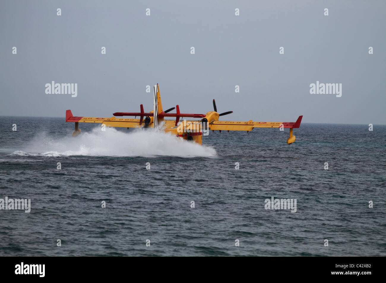 Canadair CL-145 firefighting plane tanking water - Stock Image
