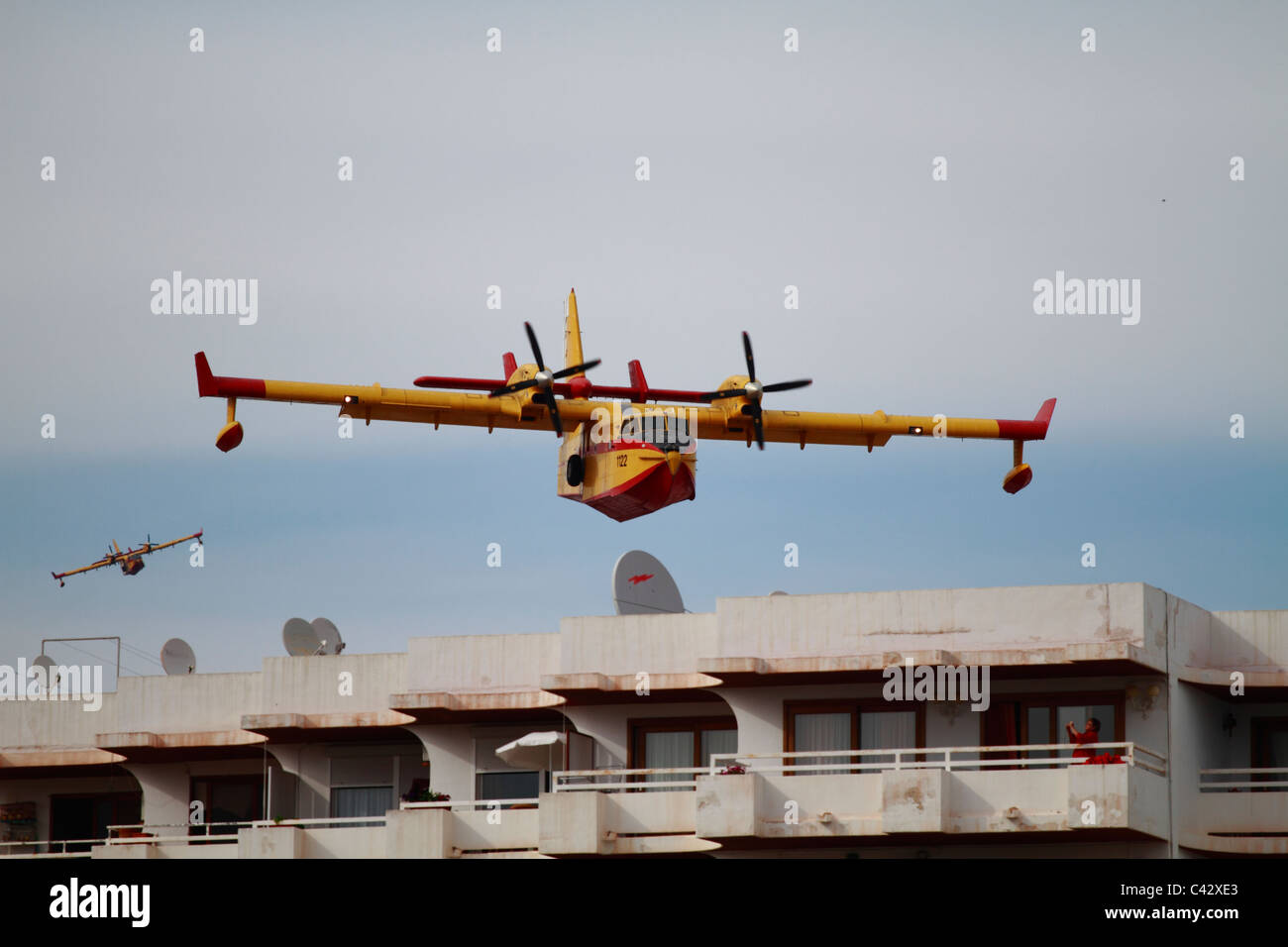Canadair CL-145 firefighting plane in flight - Stock Image