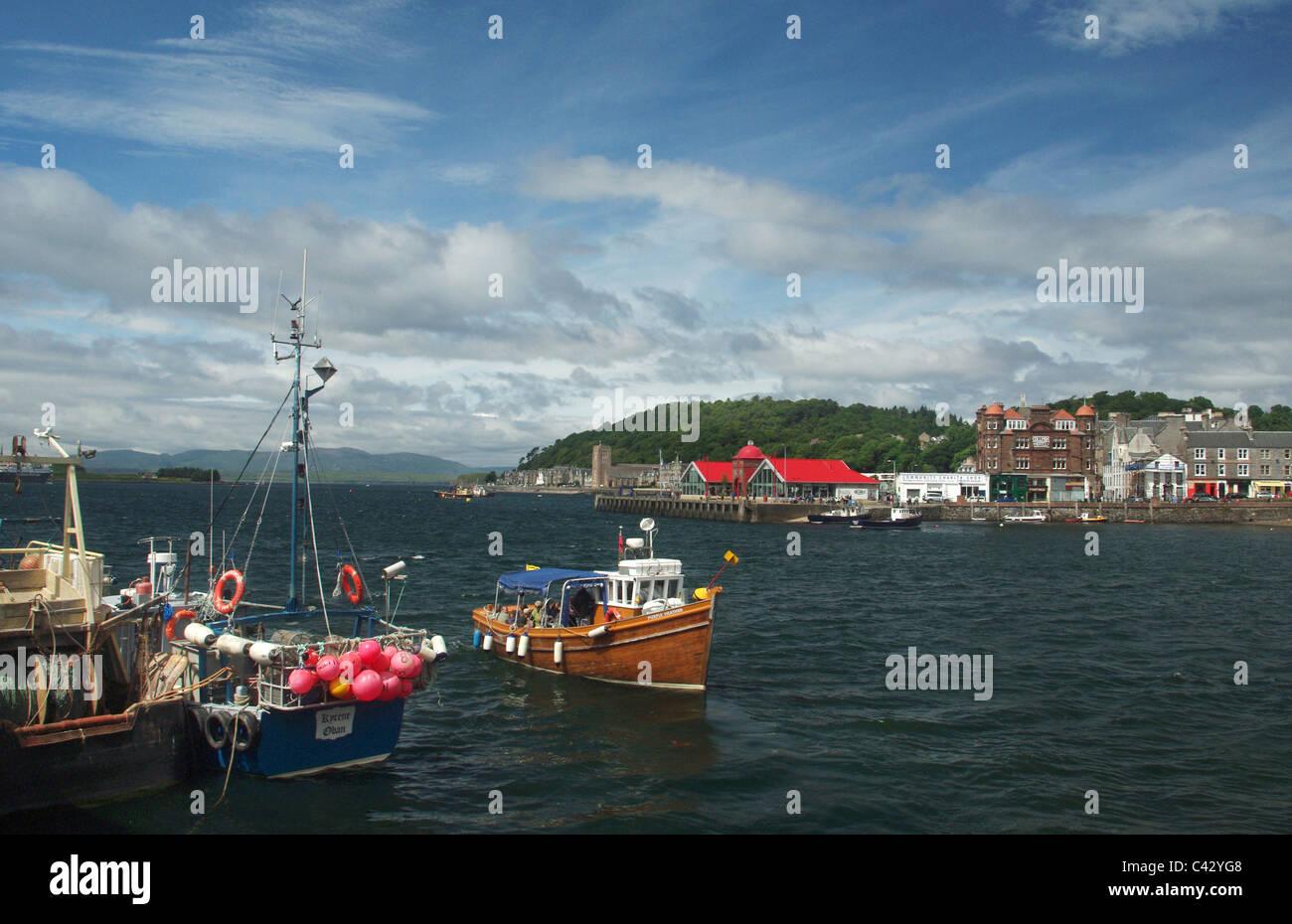 Pleasure boat entering the harbour at Oban, Scotland, UK Stock Photo
