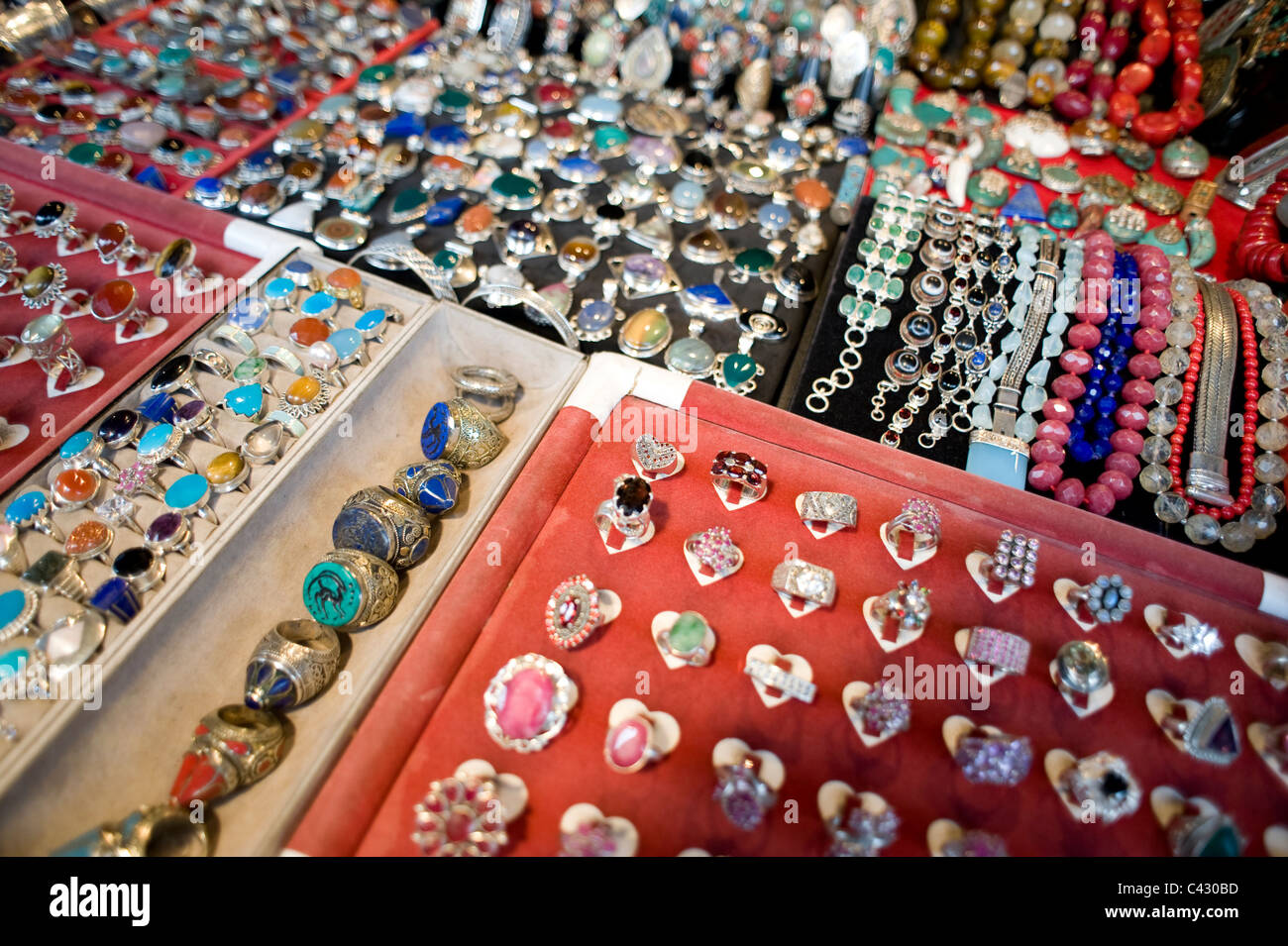 Hand-crafted jewellery on a market stall on Portobello Road, Notting Hill, London. - Stock Image