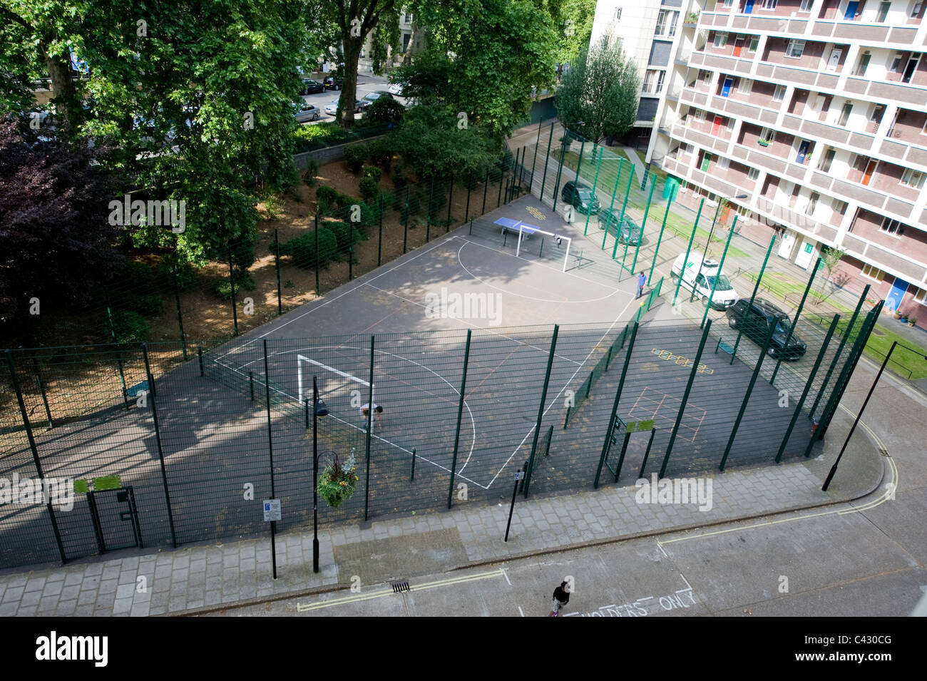 A communal play area in Hallfield Estate in London suburb of Bayswater, taken from an elevated position. - Stock Image