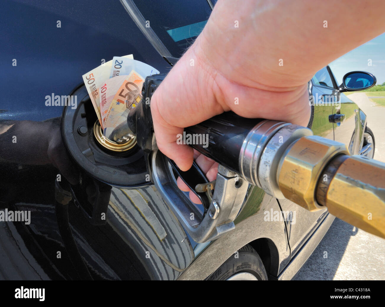 Banknotes in the Fuel Tank of a Car - Stock Image