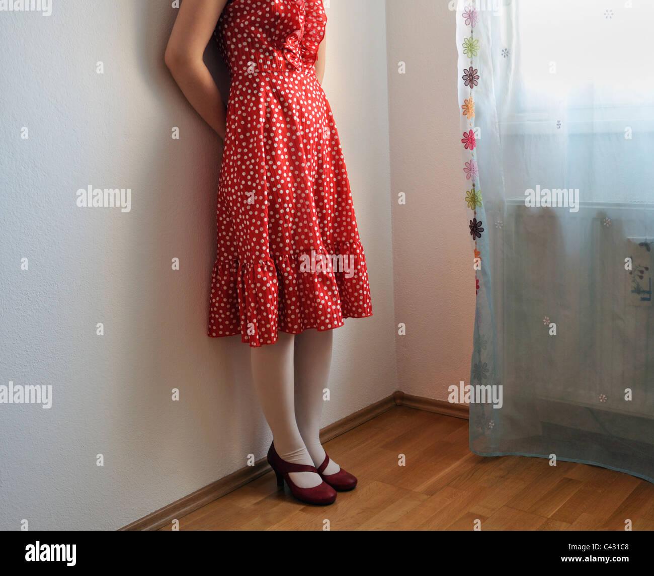 Young woman wearing polka dot dress - Stock Image