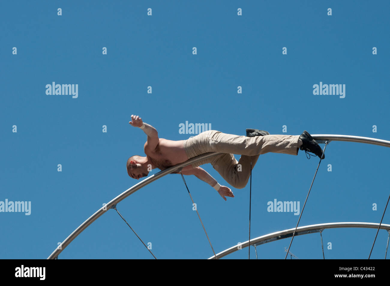 French acrobats perform for Festival of San Isidro, Plaza de la Corrala in Lavapies, Madrid, Spain - Stock Image