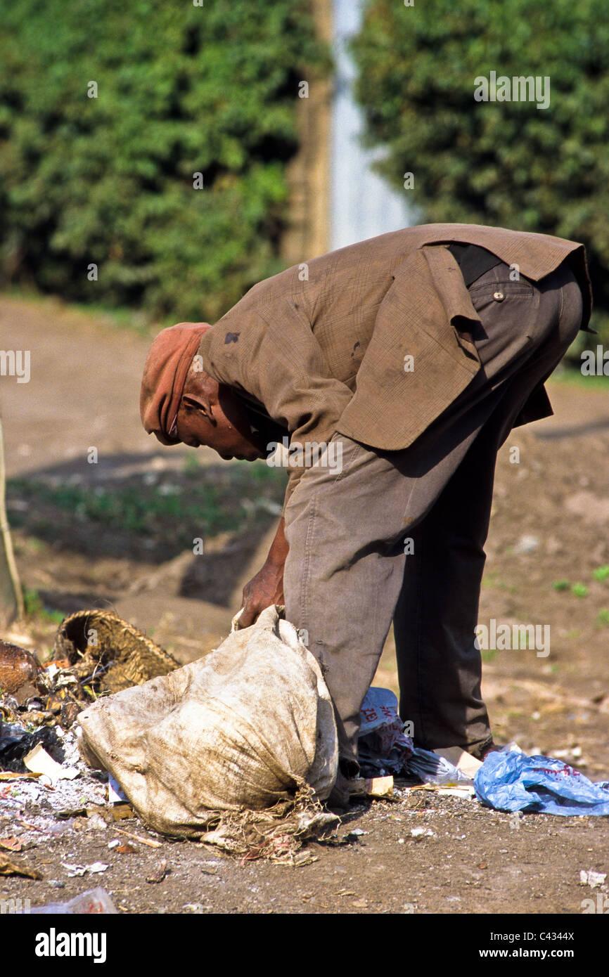Man searching through garbage, Nairobi, Kenya - Stock Image