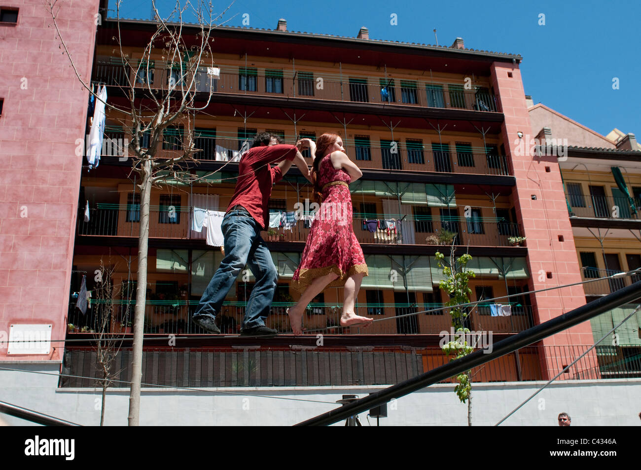 French duo Les Colporteurs perform on line for Festival of San Isidro, Plaza de la Corrala in Lavapies, Madrid, - Stock Image