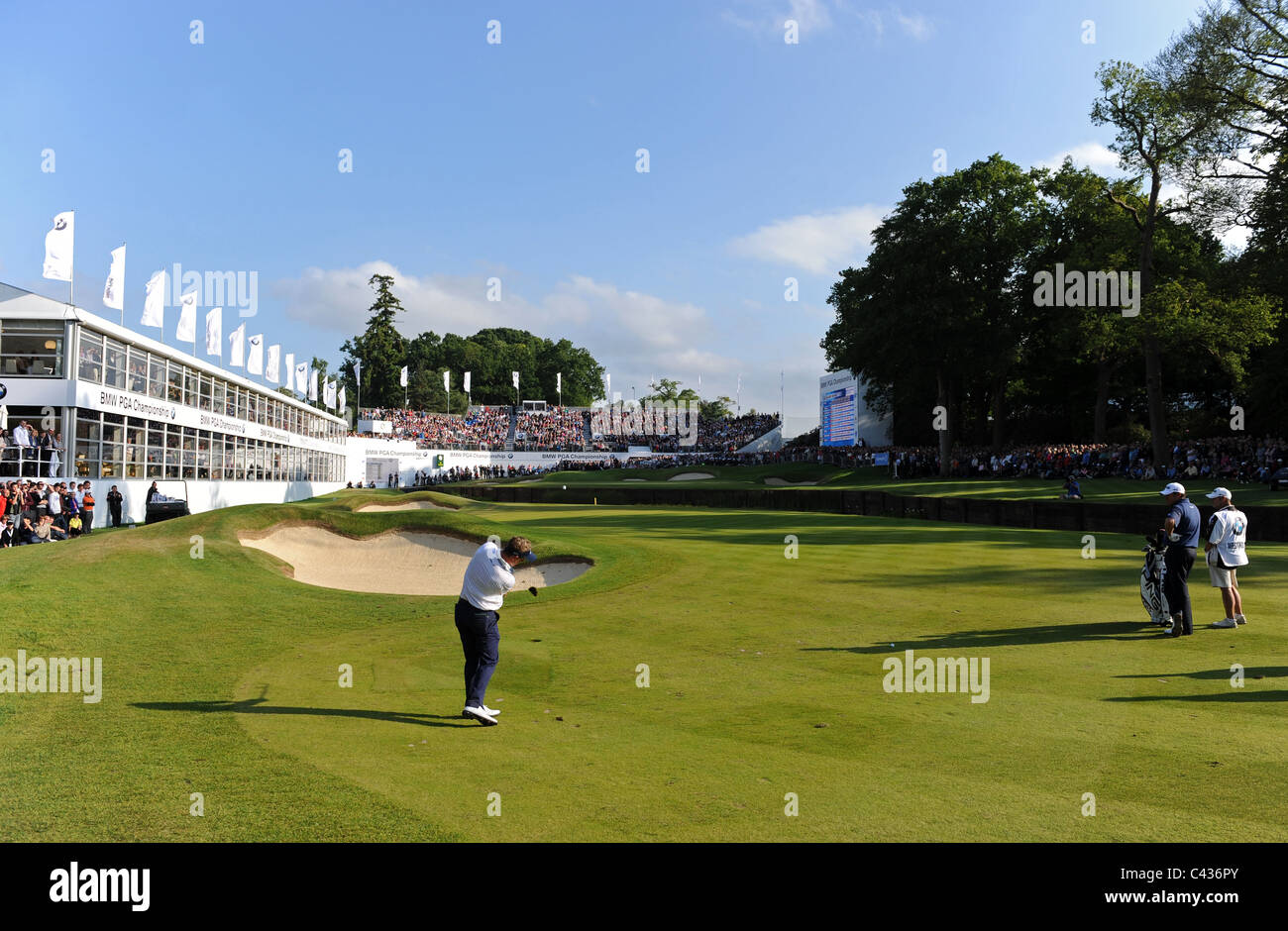 Professional Golfer Luke Donald plays an approach shot on the 18th hole at Wentworth - Stock Image