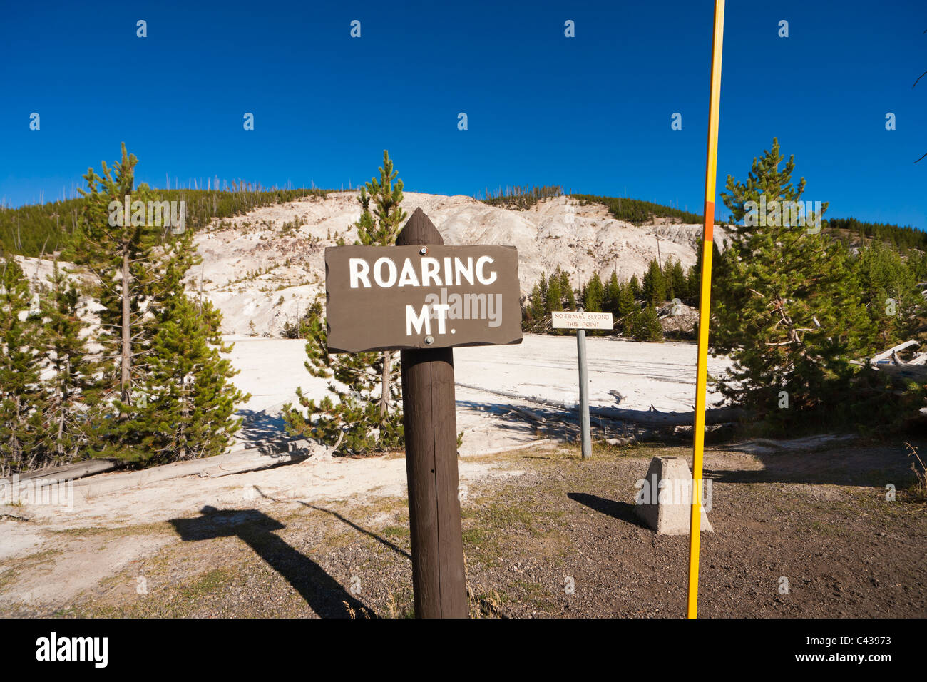 Roaring Mountain Yellowstone National Park signs and yardstick. Sign: no travel beyond this point. US Survey marker. - Stock Image