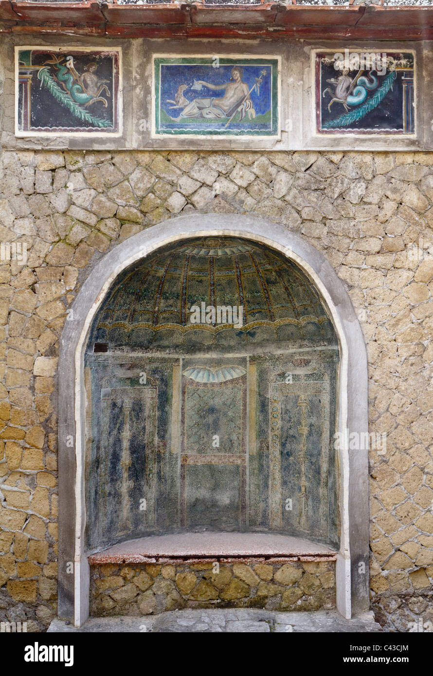 Ancient Roman wall built of volcanic tufo with murals depicting